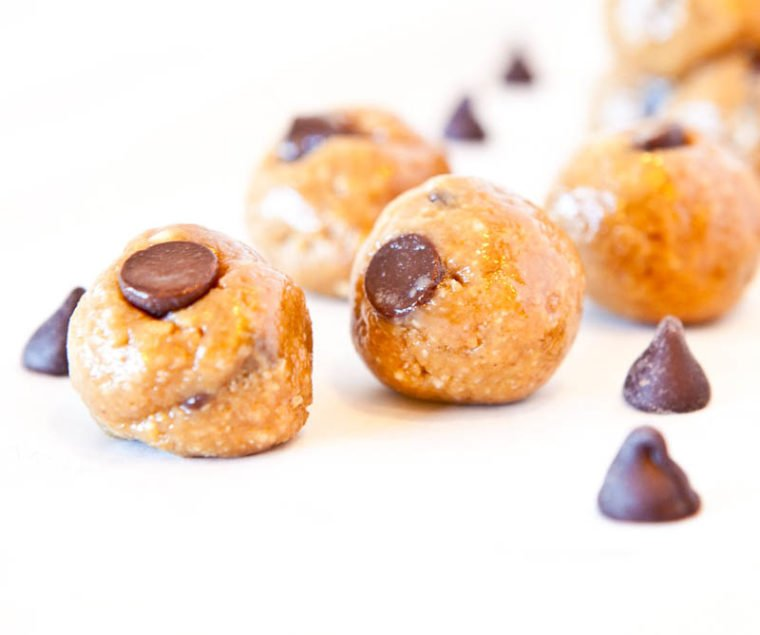 Close up of two No Bake Peanut Butter Biscoff Cookie Dough Bites showing chocolate chips