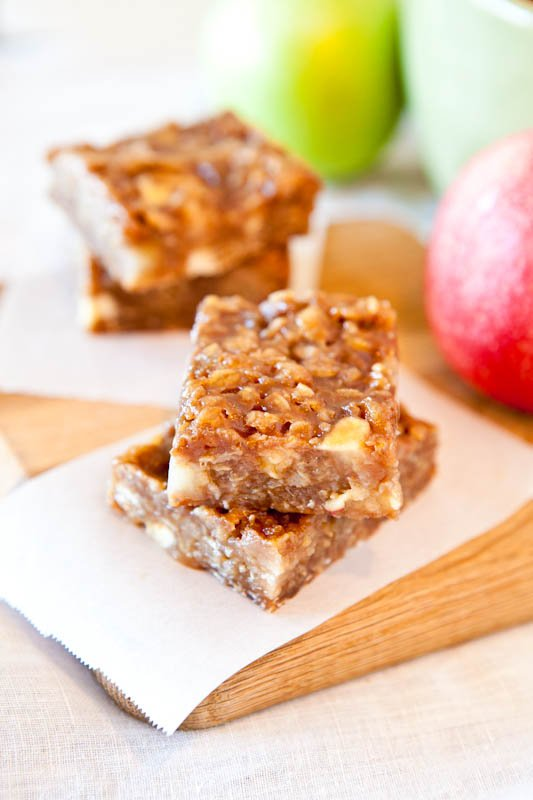 Caramel Apple Bars stacked on parchment paper