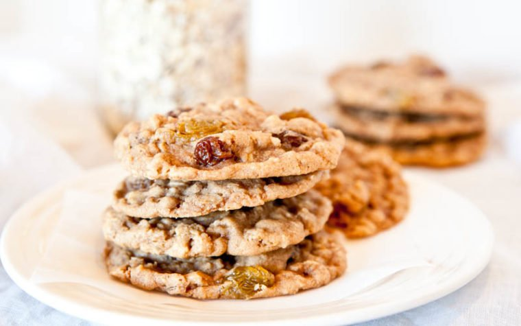 Up close of Oatmeal Raisin Cookies stacked on white plate