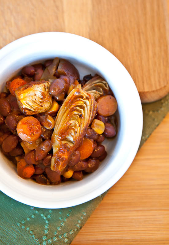 Overhead of picy Baked Black Beans with Vegetables in white bowl