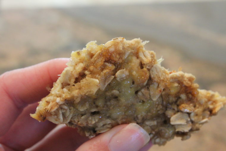 Hand holding portion of Biggie Microwave Banana Oat Cakes
