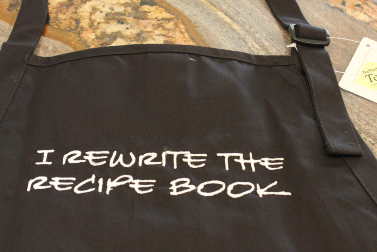 Apron that says I Rewrite The Recipe Book