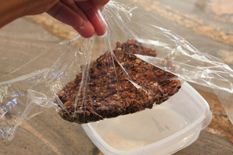 Microwave Chocolate Peanut Butter & Oat Snack Bar mixture being wrapped in plastic wrap