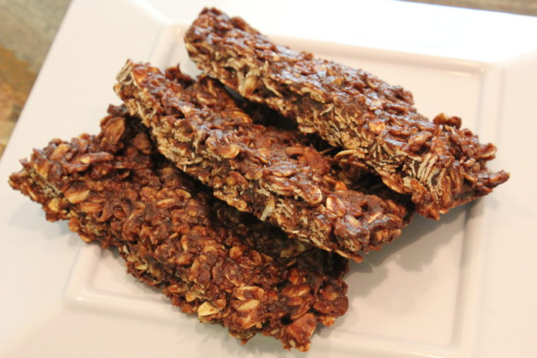 Sliced Microwave Chocolate Peanut Butter & Oat Snack Bars on white plate