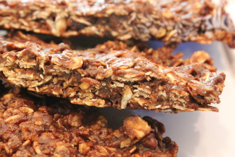 Side view of layered Microwave Chocolate Peanut Butter & Oat Snack Bars