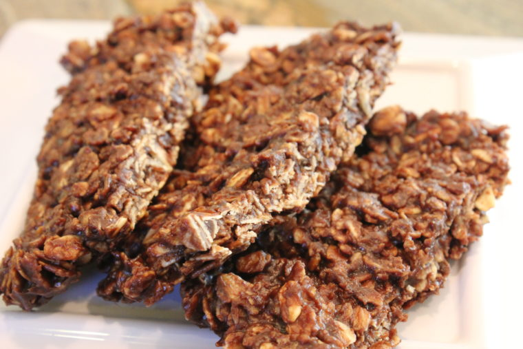 Three Microwave Chocolate Peanut Butter & Oat Snack Bars on white plate