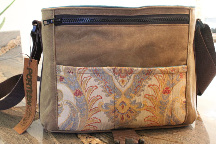 Close up of front of camera bag with flap flipped over