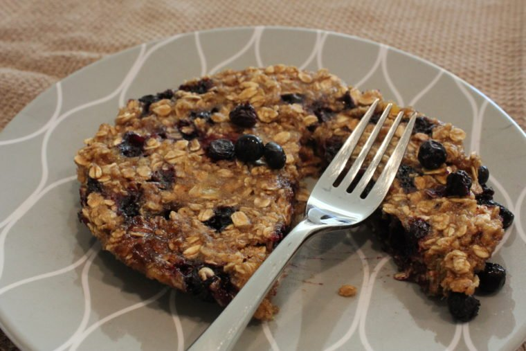 Slice taken out of Microwave Blueberry Banana Oat Cakes with fork