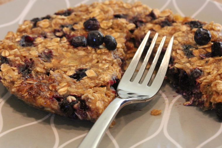 Close up of Microwave Blueberry Banana Oat Cakes with slice taken on on plate with fork