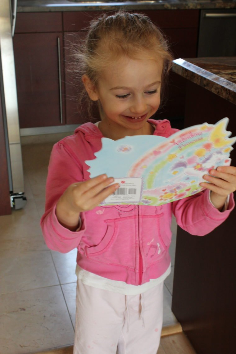 Young girl reading a Valentines card