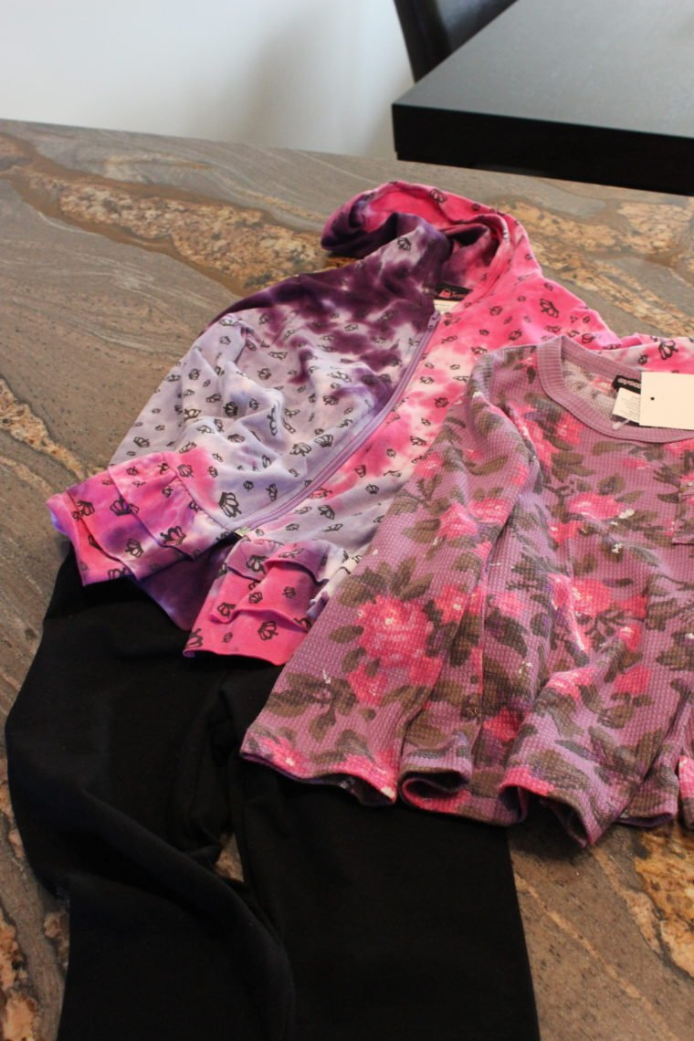 Two outfits for young girl on countertop