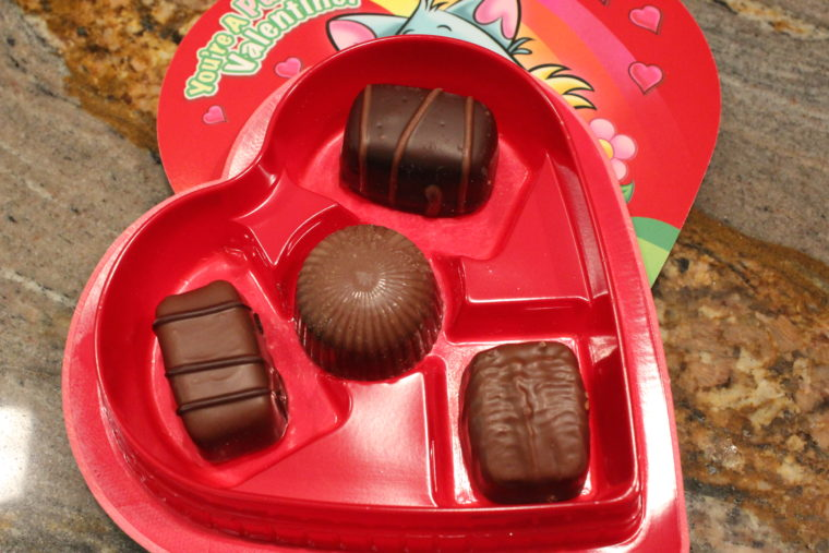 Inside box of chocolate with four chocolates