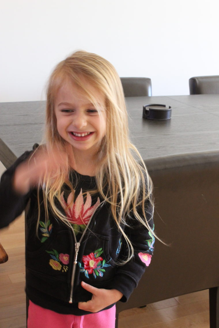 Young girl with hair down smiling
