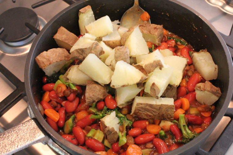 Diced potatoes added to pot with ingredients