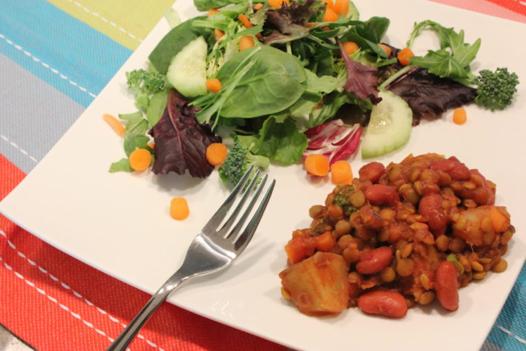 Vegan Sloppy Joes on plate with mixed vegetable salad