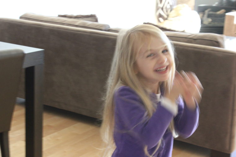 Young girl in dinging room laughing