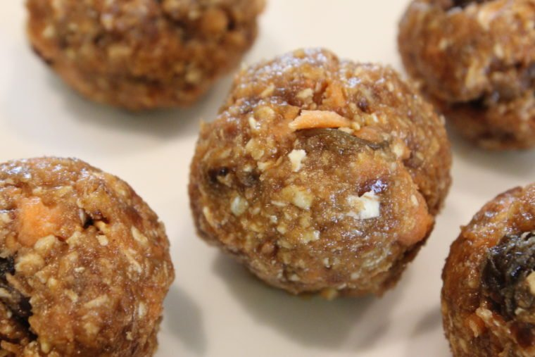 Close up of No Bake Oatmeal Raisin Carrot Cake Bites on white dish