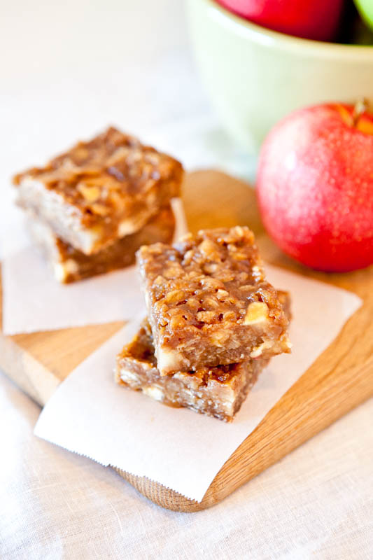 Stacked Caramel Apple Bars on parchment paper