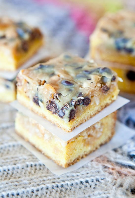 Two stacked Coconut Peanut Butter Magic Cake Bars