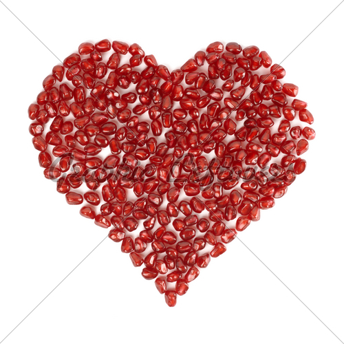 Red heart made out of pomegranate seeds