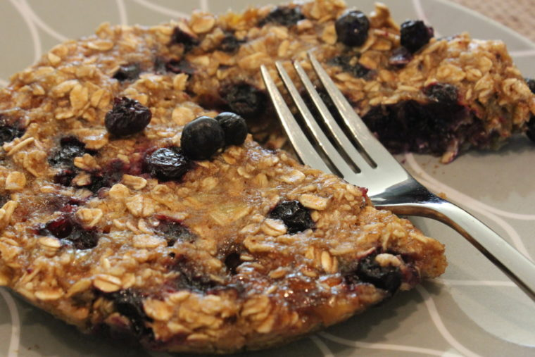 Microwave Blueberry Banana Oat Cake on plate with fork