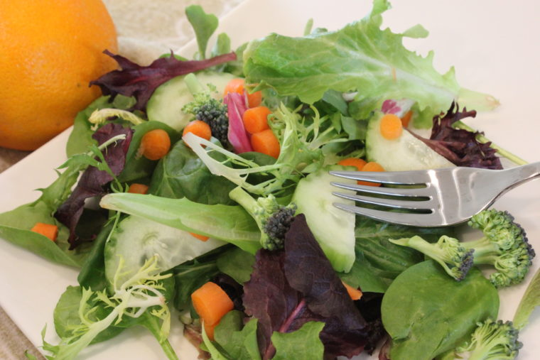 Green salad with vegetables on plate