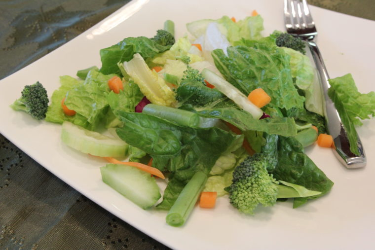Salad with mixed vegetables on white plate