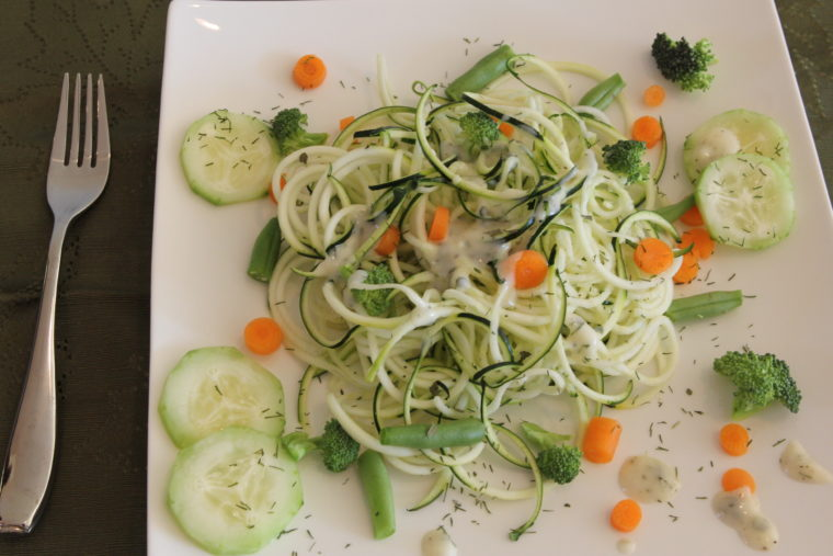 Overhead of Raw Pasta Salad with Creamy Lemon & Herb Dressing on white plate