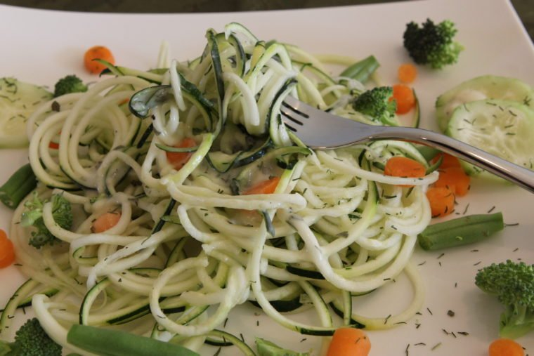 Close up of fork twirling Raw Pasta Salad with Creamy Lemon & Herb Dressing