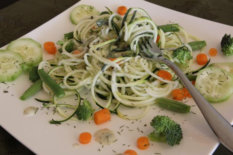 Fork swirling Raw Pasta Salad
