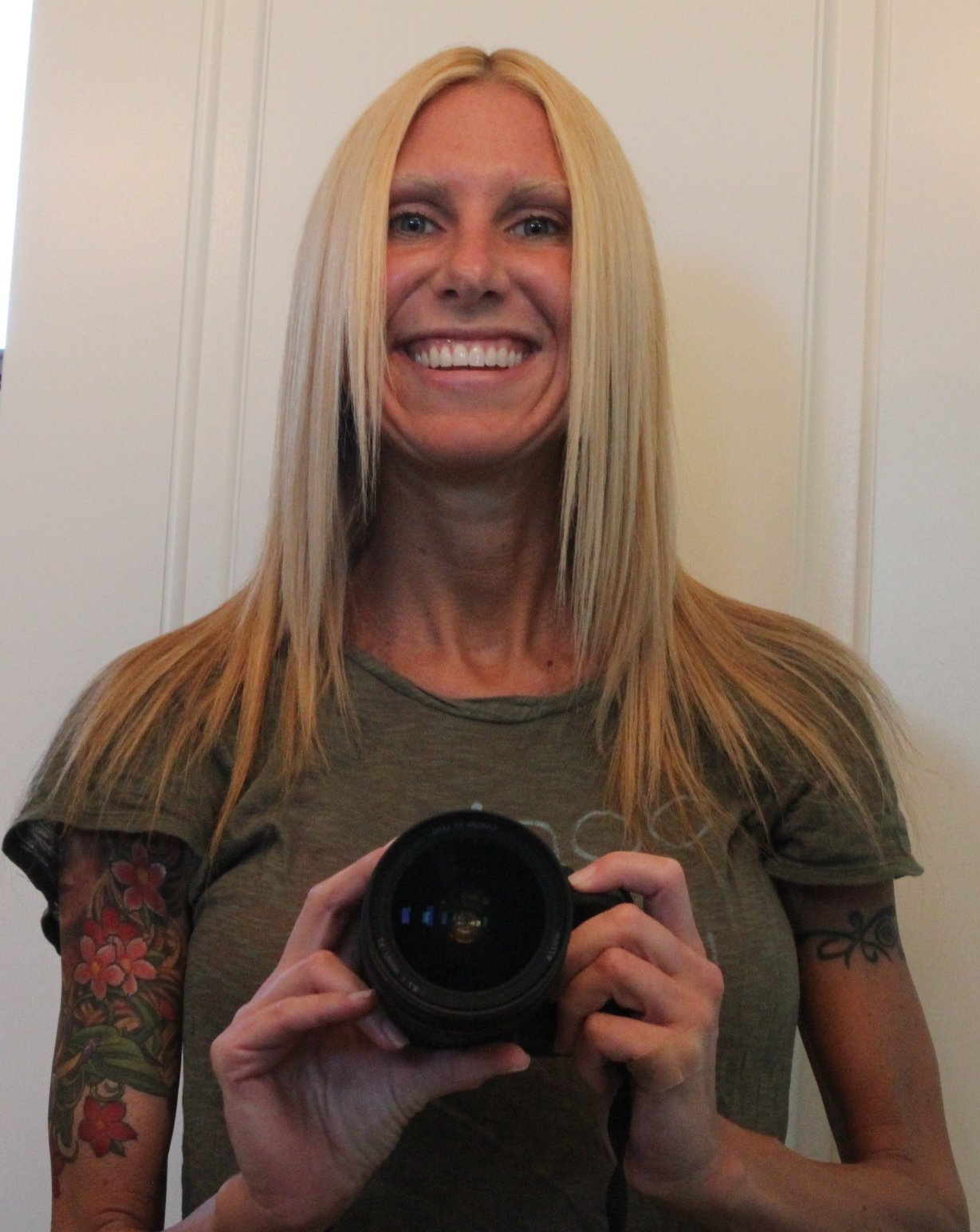 Woman with hair down holding camera