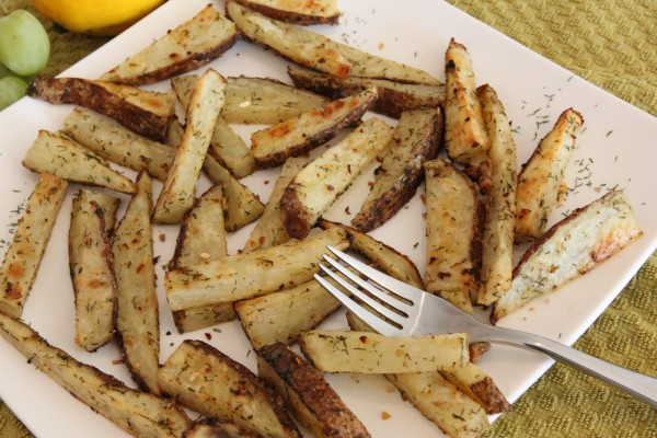 Lemon & Dill Roasted Potato Sticks on white plate with fork