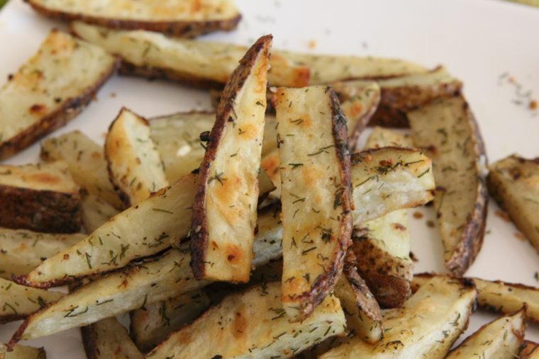 Close up of stacked Lemon & Dill Roasted Potato Sticks
