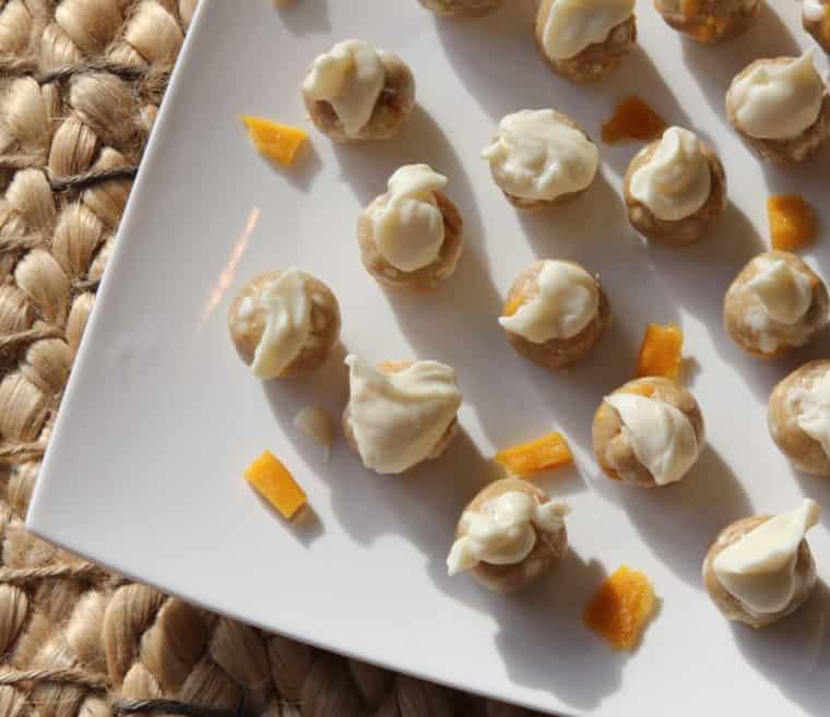 Overhead of No-Bake White Chocolate & Mango Cookie Dough Bites on white plate