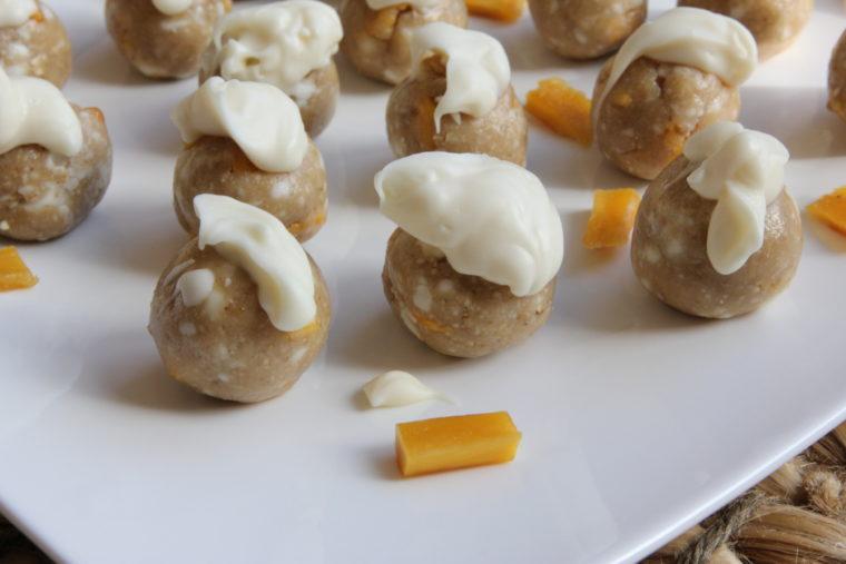 No-Bake White Chocolate & Mango Cookie Dough Bites on white plate