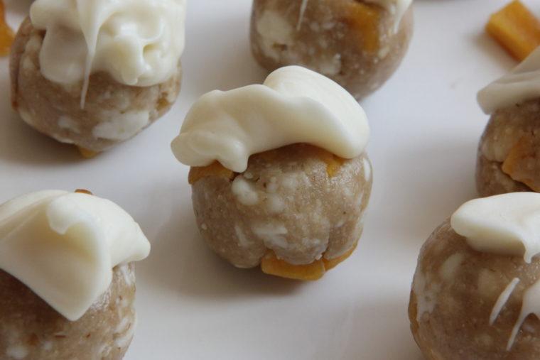 Close up of one No-Bake White Chocolate & Mango Cookie Dough Bite