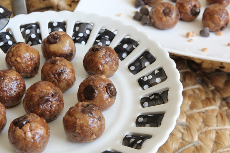 Side of cake stand with No Bake Toffee & Chocolate Chip Cookie Dough Bites
