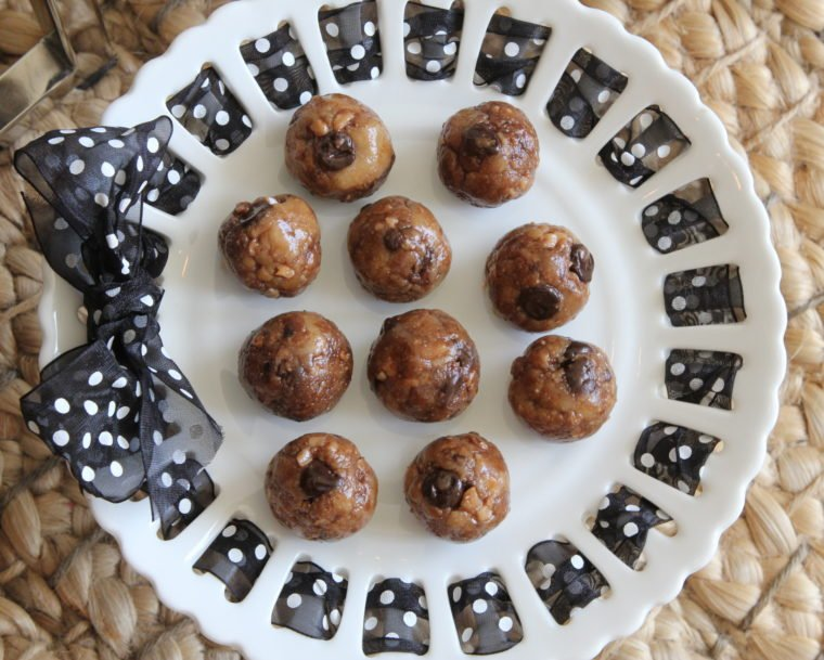 No Bake Toffee & Chocolate Chip Cookie Dough Bites formed into balls on cake stand