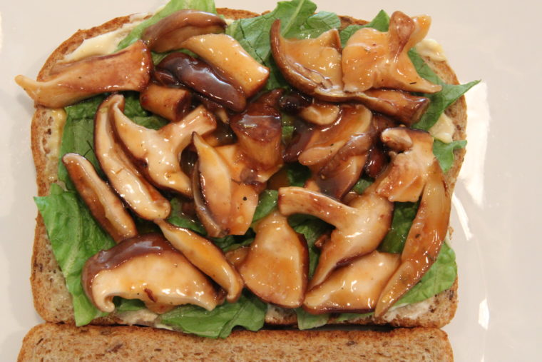 Close up of Sweet & Sour 'Shrooms on bread with lettuce