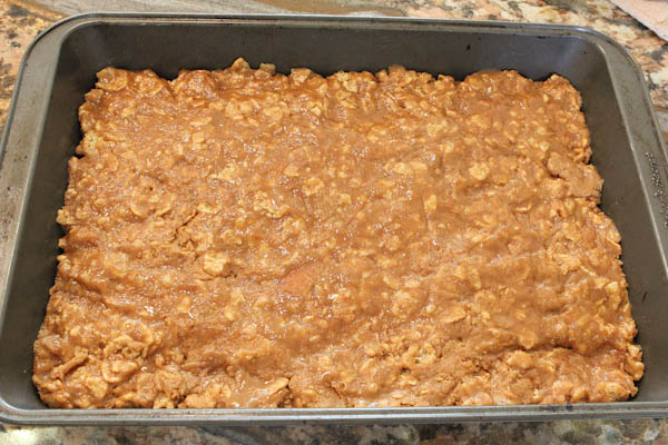 Mixed together dry and we ingredients spread into baking pan