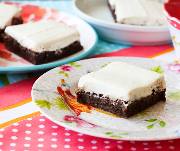 Fudgy Nutella Brownies with Cream Cheese Frosting on floral plates