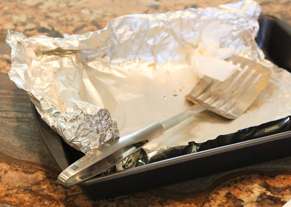 empty pan with foil and spatula
