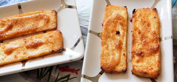 Slices of Peanut Sauce Baked Tofu on two platters