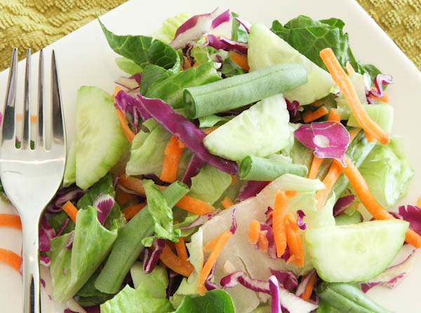 salad with snap peas with cucumbers, carrots, and cabbage