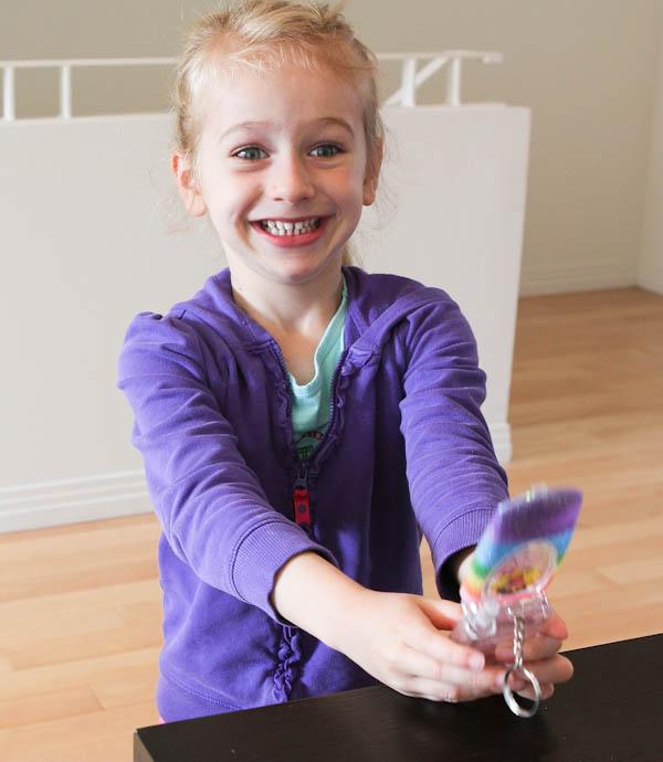 Skylar holding dora toy phone
