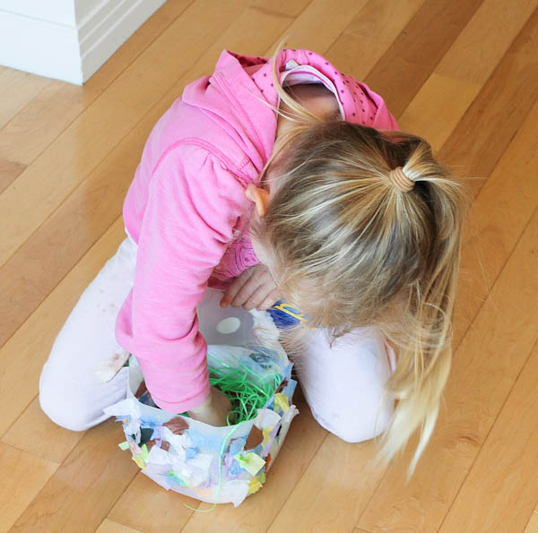 Skylar using her bunny basket