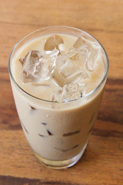Overhead of Vanilla iced coffee in glass