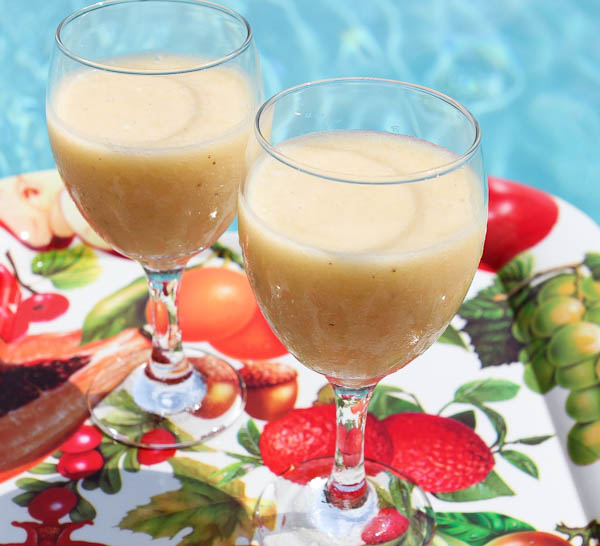 Two glasses filled with Taste of the Tropics Smoothie
