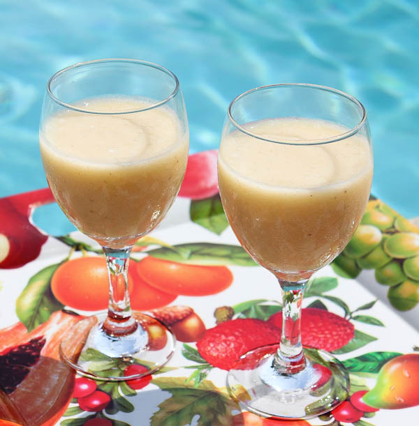 Two smoothies in glasses next to pool
