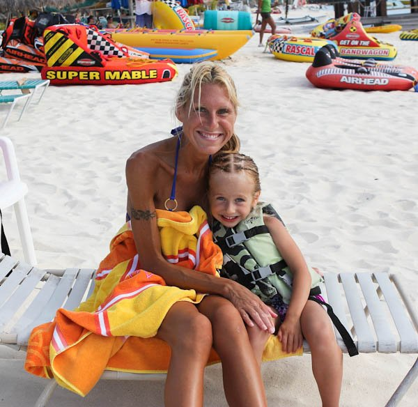 Averie and Skylar smiling on the beach